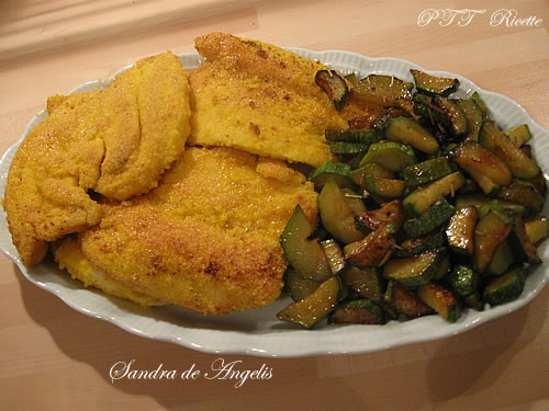 Fettine di pollo con farina di mais e mandarino