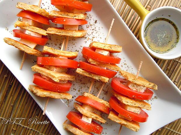 Spiedini di cecina, pomodori e treccione affumicato 2